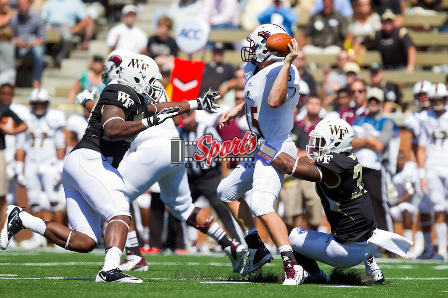 Louisiana-Monroe Warhawks quarterback Kolton Browning (15) gets rid of the ball while under pressure from Kevis Jones (37) and Josh Banks (58) of the Wake Forest Demon Deacons at BB&T Field on September 14, 2012 in Winston-Salem, North Carolina.  The Warhawks defeated the Demon Deacons 21-19.    (Brian Westerholt/Sports On Film)