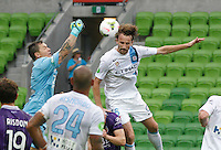 Danny Vukovis challange  Josh Kennedy   during the  A-League soccer match between Melbourne City FC and Perth Glory at AAMI Park on February 22, 2015 in Melbourne, Australia.