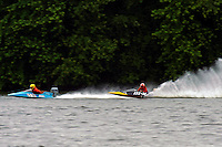 Frame 3: Marissa Affholder(151-M) races into turn 2 chasing 17-M and flips over. (stock outboard runabout)