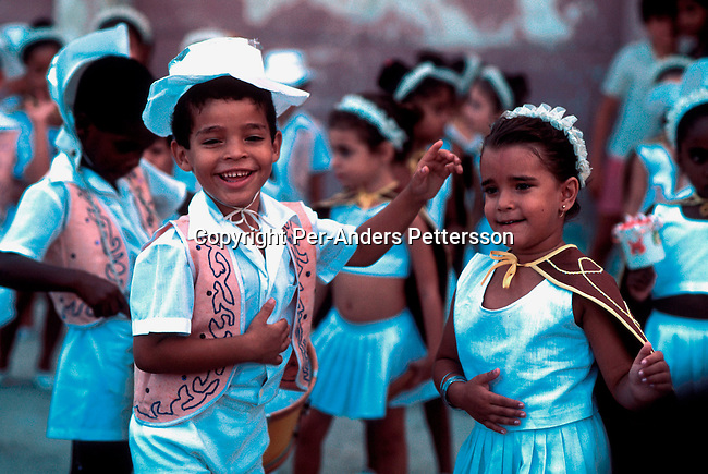 Children performing a dance and song ritual on July 2, 1993 in a square in central Havana, Cuba. Fidel Castro has ruled the communist island for over 4 decades and been in war of words with the United States all since then. They country has a good eduacation and medical level but lacks freedom of the press and speech. .Photo: Per-Anders Pettersson/ iAfrika Photos