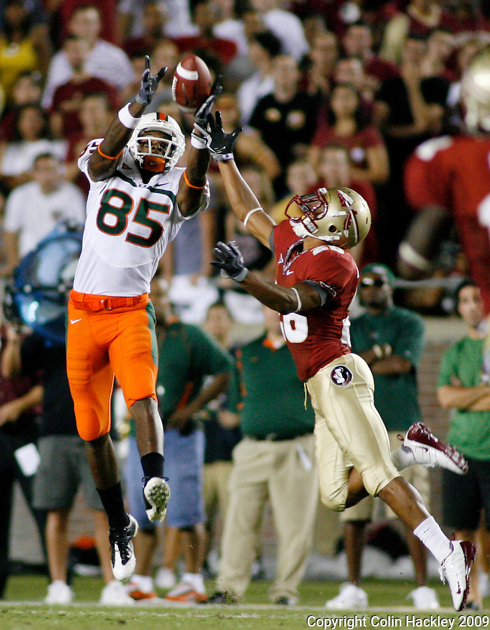 TALLAHASSEE, FL 9/7/09-FSU-MIAMIFB09 CH03-Florida State's A.J. Alexander can't keep Miami's Leonard Hankerson from making a catch during first half action Monday at Doak Campbell Stadium in Tallahassee...COLIN HACKLEY PHOTO