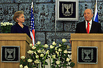 Israeli President Shimon Peres (R) and Hillary Clinton (L) speak to the press following their meeting at Peres' residency in Jerusalem, Tuesday, March 3, 2009. Clinton declared that the U.S. will work closely with any new Israeli government, and emphasized the necessity of a two-state solution to the Israeli-Palestinian conflict. Middle East envoy George Mitchell also attended the meeting. Throughout the day, Clinton is set to meet with Prime Minister-designate Binyamin Netanyahu, Prime Minister Ehud Olmert, Foreign Minister Tzipi Livni and Defense Minister Ehud Barak. Photo By: Tess Scheflan / JINI.