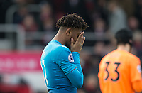 Alex Iwobi of Arsenal covers his face during the Premier League match between Bournemouth and Arsenal at the Goldsands Stadium, Bournemouth, England on 14 January 2018. Photo by Andy Rowland.