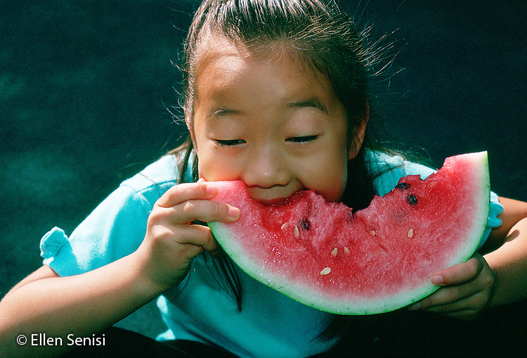 MR / Schenectady, NY.Girl (7, adopted, Korean/American) eats watermelon..MR: Row2.PN#: 18539                                   FC#: 11825-00217.scan from slide.©Ellen B. Senisi
