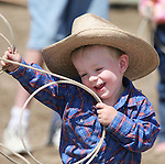 Fallon's Brody Allyn laughs while competing in the Pee-Wee Dummy Roping event at the Fallon Junior Rodeo.  Photo by Tom Smedes.