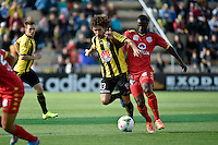 Albert Riera ( Phoenix ) and Bruce Djite ( Adelaide ) in action during the A League - Wellington Phoenix v Adelaide United at Hutt Recreational Ground, Lower Hutt, New Zealand on Saturday 7 March 2015. <br /> Photo by Masanori Udagawa. <br /> www.photowellington.photoshelter.com.