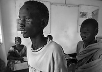 A young man suffering from tuberculosis arrives for treatment in a clinic in Juba, Sudan on July 25, 2005.