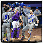 First baseman Danny Wilson (7) of the UNC Asheville Bulldogs is congratulated after hitting a two-run home run in a game against the Furman Paladins on Wednesday, February 27, 2019, at Latham Baseball Stadium on the Furman University campus in Greenville, South Carolina. UNC Asheville won, 4-3. (Tom Priddy/Four Seam Images)
