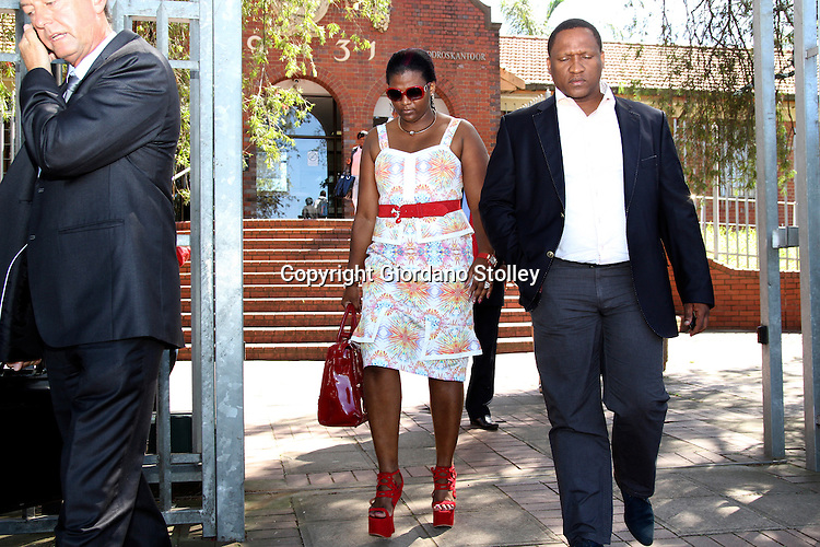 "DURBAN - 21 February 2013 - Durban business woman Mabongi Flora-Junior ""Shauwn"" Mpisane (center) leaves the Pinetown Magistrates Court along with husband Sibusiso Mpisane Mpisane (right) after being told she will stand trial on charges of fraud, corruption and defeating the ends of justice in September. On the phone on the left is her lawyer JimmyHowse. Shauwn is accused of attempting to get a state witness to alter invoices that are evidence in another case involving tax evasion. Picture: Giordano Stolley/Allied Picture Press/APP"