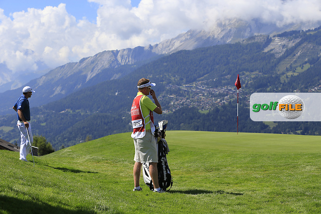 Gareth MAYBIN (NIR) and caddy Basil at the 7th green during Saturday's Round 3 of the 2014 Omega European Masters held at the Crans Montana Golf Club, Crans-sur-Sierre, Switzerland.: Picture Eoin Clarke, www.golffile.ie: 6th September 2014