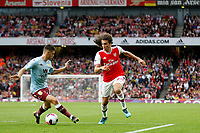Mattéo Guendouzi of Arsenal takes on Frédéric Guilbert of Aston Villa during the Premier League match between Arsenal and Aston Villa at the Emirates Stadium, London, England on 22 September 2019. Photo by Carlton Myrie / PRiME Media Images.