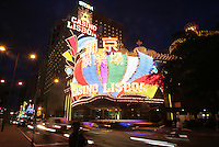 A pedestrian waits to cross the road in front of the Casino Lisboa, Macau, 25 April 2005. It was announced Monday that Macau gaming company Melco International Development has qualified to participate in the request for the proposal for an integrated resort, to be issued by the Singapore government in the second quarter of 2005. Dr Stanley Ho, the reigning casino mogul of the gaming industry in Macau, retains a controlling stake in Melco International Development via it's parent company STDM, which runs the Casino Lisboa, and of which Stanley Ho is the majority shareholder.