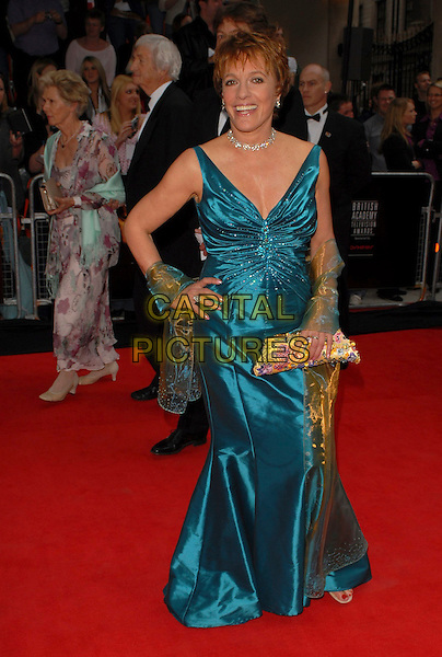 ESTHER RANTZEN.Arrivals at the Pioneer British Academy Television Awards 2006 at the Grosvenor House Hotel, London, UK..May 7th, 2006 .Ref: CAN.BAFTA TV.full length satin blue dress wrap hand on hip clutch purse.www.capitalpictures.com.sales@capitalpictures.com.©Capital Pictures
