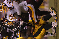 26 August 2005:  LaVar Arrington (56) tackles Steeler RB Veron Haynes (34).<br />