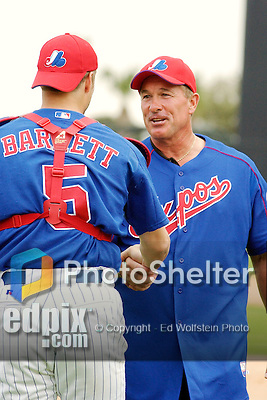 """28 February 2003: Hall of Fame catcher, and former Montreal Expo, Gary """"The Kid"""" Carter chats with Expos catcher Michael Barrett prior to a Spring Training game at Space Coast Stadium in Viera, Florida. Carter became the first Montreal Expo to be inducted into the Baseball Hall of Fame later that year. Mandatory Credit: Ed Wolfstein Photo"""