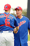 "28 February 2003: Hall of Fame catcher, and former Montreal Expo, Gary ""The Kid"" Carter chats with Expos catcher Michael Barrett prior to a Spring Training game at Space Coast Stadium in Viera, Florida. Carter became the first Montreal Expo to be inducted into the Baseball Hall of Fame later that year. Mandatory Credit: Ed Wolfstein Photo"