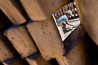 Moisés, a thirteen-year-old Salvadoran boy, is seen working behind a wall of raw bricks at a brick factory in Istahua, El Salvador, 21 December 2013. Child labour is a common practice at the artisanal brick factories, found mainly in rural areas of El Salvador. Poverty and insufficient earnings in agriculture force parents to employ their own children, in an effort to ensure the livelihood for the whole family. Children aged 8-10 are allowed to work slower, with smaller volumes of clay, while children aged 12 and up work regularly, 8-10 hours a day, 6 days a week.