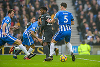 Michy Batshuayi of Chelsea (23) sets up Willian of Chelsea (22) goal with a backheel past Lewis Dunk of Brighton & Hove Albion (5)   during the Premier League match between Brighton and Hove Albion and Chelsea at the American Express Community Stadium, Brighton and Hove, England on 20 January 2018. Photo by Edward Thomas / PRiME Media Images.