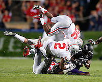 Northwestern Wildcats wide receiver Rashad Lawrence (17) is tackled by Ohio State Buckeyes linebacker Ryan Shazier (2) and Ohio State Buckeyes cornerback Armani Reeves (26) during Saturday's NCAA Division I football game at Ryan Field in Evanston on October 5 2013. (Barbara J. Perenic/The Columbus Dispatch)