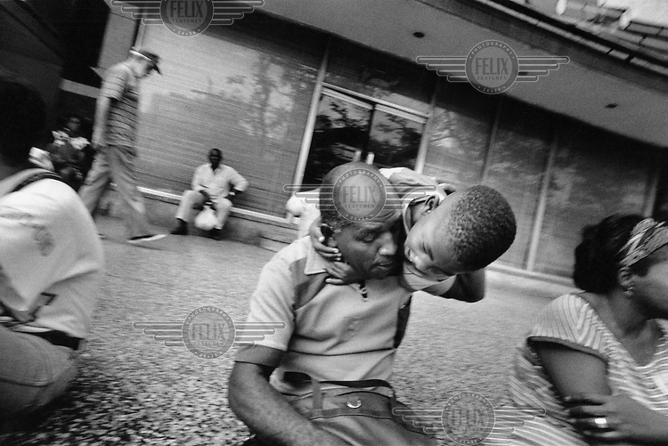 Child playing with his grandfather..