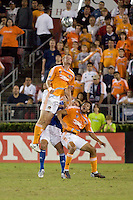 Houston Dynamo forward Nate Jaqua (21) goes up for the header over Houston Dynamo forward Brian Ching (25). The Houston Dynamo defeated the Kansas City Wizards 2-0 at Robertson Stadium in Houston, TX on November 10, 2007 to capture the MLS Western Conference Championship. The Houston Dynamo will take on the New England Revolution in the MLS Cup Final on November 18, 2007 at RFK Stadium in Washington D.C.