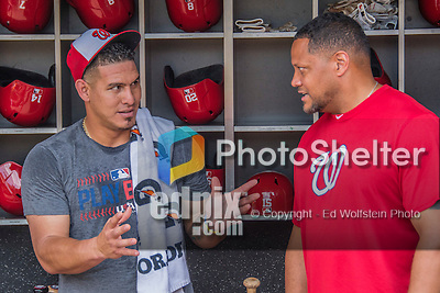 23 July 2016: Washington Nationals catcher Wilson Ramos chats with Rob McDonald, Vice President of Clubhouse Operations & Team Travel, in the dugout prior to a game against the San Diego Padres at Nationals Park in Washington, DC. The Nationals defeated the Padres 3-2 on a Stephen Drew pinch-hit, walk-off triple in the bottom of the 9th inning to tie their series at one game apiece. Mandatory Credit: Ed Wolfstein Photo *** RAW (NEF) Image File Available ***
