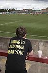 A supporter of Alloa Athletc football club watching his team at Ochilview stadium, Larbert, during their Irn Bru Scottish League second division match against Stenhousemuir. Alloa won the match by one goal to nil against their local rivals in a match watched by 619 spectators.