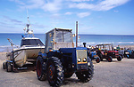 AMFXFB Tractor and fishing boats Cromer Norfolk England