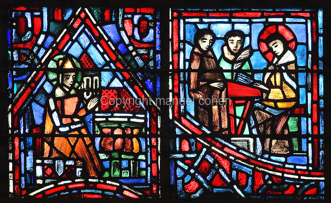Fulbert as treasurer of the Church of St Hilary of Poitiers (left) and Fulbert the man of letters (right), sitting at a desk with inkstand and quill and 2 students, from the Life of Fulbert stained glass window, in the south transept of Chartres Cathedral, Eure-et-Loir, France. This window replaces the original 13th century window depicting the Life of St Blaise, which was destroyed in 1791. It was created in 1954 by Francois Lorin as a gift of the Institute of American Architects, on a theme chosen by the Canon Yves Delaporte. It depicts the life of Fulbert, bishop of Chartres in the 11th century. Chartres cathedral was built 1194-1250 and is a fine example of Gothic architecture. Most of its windows date from 1205-40 although a few earlier 12th century examples are also intact. It was declared a UNESCO World Heritage Site in 1979. Picture by Manuel Cohen