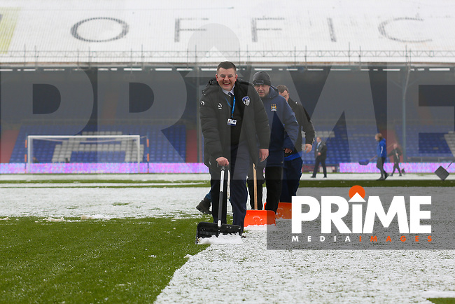 Groundsman clears the snow of the pitch ahead of the Sky Bet League 1 match between Oldham Athletic and Northampton Town at Boundary Park, Oldham, England on 9 December 2017. Photo by Juel Miah / PRiME Media Images.