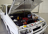 BNPS.co.uk (01202 558833)<br /> Pic: PPMMiltonKeynes/BNPS<br /> <br /> Under the hood...<br /> <br /> A pre-production prototype of the legendary Ford Sierra Cosworth RS500 has emerged for sale for a whopping £120,000.<br /> <br /> The RS500 was the road going version of Ford's iconic rally car with only 500 built in order to meet racing regulations.<br /> <br /> This one was the very first to be built in 1987 and in more recent times was road tested by Richard Hammond on the Grand Tour.