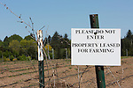 Sign marking border of farmed land.  Community Supported Agriculture Farm, 47th Avenue Farm, plowed and ready for sprint planting.  Luscher Farms Park, City of Lake Oswego, Oregon, USA.