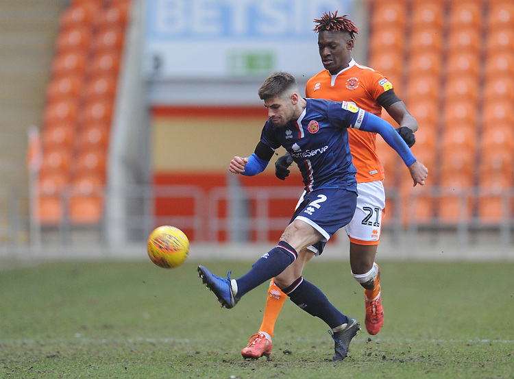 Blackpool's Armand Gnanduillet vies for possession with Walsall's Joe Edwards<br /> <br /> Photographer Kevin Barnes/CameraSport<br /> <br /> The EFL Sky Bet League One - Blackpool v Walsall - Saturday 9th February 2019 - Bloomfield Road - Blackpool<br /> <br /> World Copyright &copy; 2019 CameraSport. All rights reserved. 43 Linden Ave. Countesthorpe. Leicester. England. LE8 5PG - Tel: +44 (0) 116 277 4147 - admin@camerasport.com - www.camerasport.com