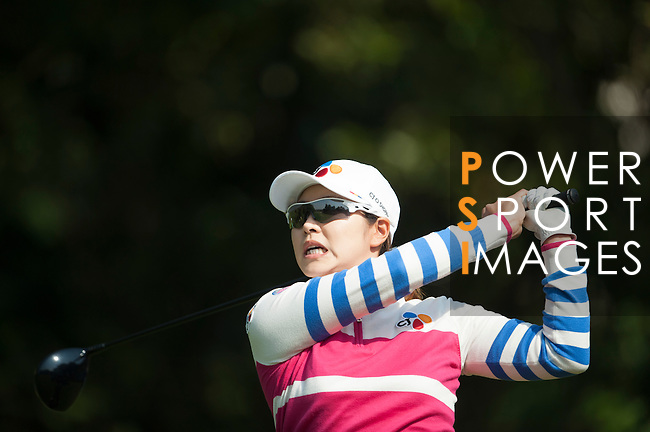 Ji-Hyun Kim of Korea in action during the Hyundai China Ladies Open 2014 at World Cup Course in Mission Hills Shenzhen on December 14 2014, in Shenzhen, China. Photo by Xaume Olleros / Power Sport Images
