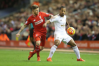 Wayne Routledge competes with Alberto Moreno during the Barclays Premier League Match between Liverpool and Swansea City played at Anfield, Liverpool on 29th November 2015