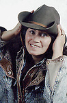 WOMAN POSES IN COWBOY HAT