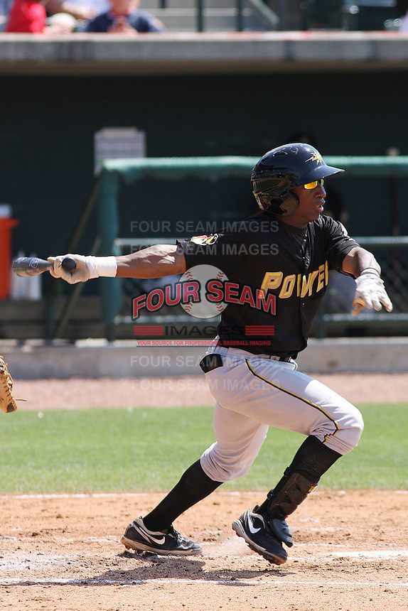 Adenson Chourio #5 of the West Virginia Power hitting in a game against the Charleston RiverDogs on April 14, 2010 in Charleston, SC.