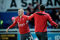 Lincoln City's Harry Anderson, left, and Lincoln City's Michael Bostwick during the pre-match warm-up<br /> <br /> Photographer Chris Vaughan/CameraSport<br /> <br /> The EFL Sky Bet League Two - Mansfield Town v Lincoln City - Monday 18th March 2019 - Field Mill - Mansfield<br /> <br /> World Copyright © 2019 CameraSport. All rights reserved. 43 Linden Ave. Countesthorpe. Leicester. England. LE8 5PG - Tel: +44 (0) 116 277 4147 - admin@camerasport.com - www.camerasport.com