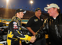 Apr 16, 2009; Avondale, AZ, USA; NASCAR Camping World Series West driver Blake Koch (left) shakes hands with car owner Richard Childress prior to the Jimmie Johnson Foundation 150 at Phoenix International Raceway. Mandatory Credit: Mark J. Rebilas-