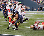 Seattle Seahawks wide receiver Doug Baldwin beaks a tackle by  San Francisco 49ers linebacker Larry Grant and scores a 13-yard touchdown at CenturyLink Field in Seattle, Washington on December 24, 2011.  The 49ers came from behind to beat the Seahawks 19-17. ©2011 Jim Bryant Photo. All Rights Reserved.