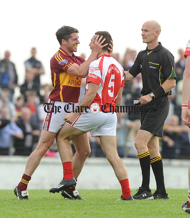 Gordon Kelly of Miltown gets to grips with Dean Ryan of Eire Og during their quarter final at Kilmihil. Photograph by John Kelly.