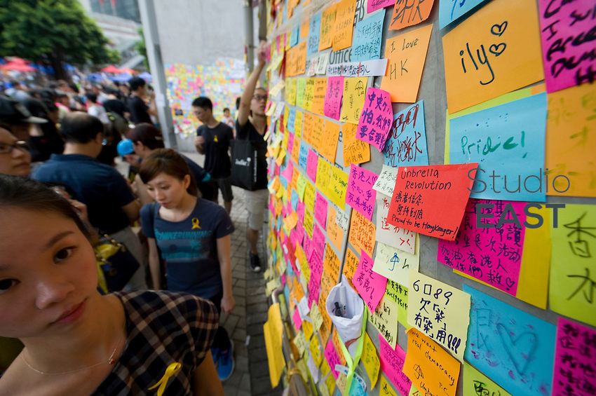 HONG KONG, HONG KONG SAR, CHINA - OCTOBER 02: This wall, nicknamed the 'John Lennon' wall, is where demonstrators leave hundreds of messages on the Government buildings in Admirality, Hong Kong, on October 2, 2014. The 'Umbrella revolution' or 'Occupy Central' is a civil disobedience movement that began in response to China's decision to allow only Beijing-vetted candidates to stand in the city's 2017 election for the top civil position of chief executive. Thousands of pro-democracy supporters are calling for open elections and the resignation of Hong Kong's Chief Executive Leung Chun-ying. (Photo by Lucas Schifres/Getty Images)