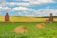 Grain elevators and bales<br /> Neidpath<br /> Saskatchewan<br /> Canada