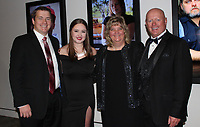 NWA Democrat-Gazette/CARIN SCHOPPMEYER Josh Blount and Anna Grace McMoran (from left) and Lisa and Jim Blount gather at Art of Hospice on Nov. 2.