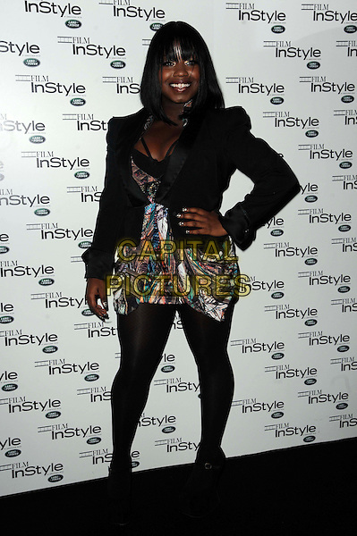 "Misha ""Misha B"" Bryan.The InStyle magazine 10th anniversary party, Sanctum Soho hotel, Warwick St., London, England..November 22nd, 2011.full length black blazer jacket dress tights white print goody bag hand on hip.CAP/CAS.©Bob Cass/Capital Pictures."
