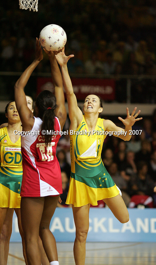 16.11.2007 England's Pamela Cookey and Australian Liz Ellis in action during the Australia v England match at the New World Netball World Champs held at Trusts Stadium Auckland New Zealand. Mandatory Photo Credit ©Michael Bradley.