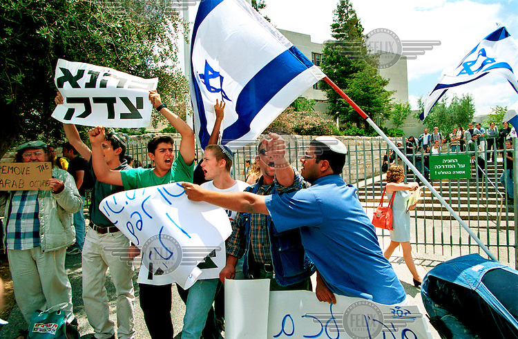 """Extreme right wing Jews demonstrate in front of an Israeli Arab student group demonstrating their solidarity with the Palestinians, at the entrance to the Hebrew University campus in Mt. Scopus, East Jerusalem..The demonstration was held on """"Naqba Day"""". A day Palestinians comemorate as their 'holocaust day', with the birth of the state of Israel and the  accompanying removal of hundreds of thousands of Palestinians from their lands and homes in 1948.."""