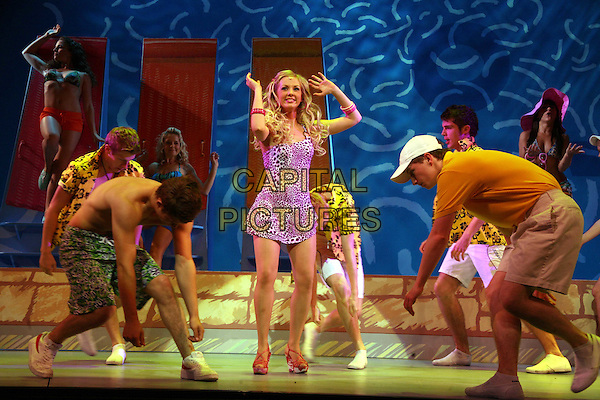 LAUREN HALL as Sharpay with the cast .High School Musical II at The Wimbledon Theatre, London, England..August 21st, 2009.hsm 2 stage acting play full length pink dress dancing arms in air leopard print .CAP/DS.©Dudley Smith/Capital Pictures