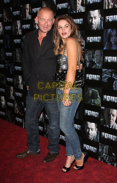 Sean Pertwee and Kierston Wareing.UK premiere of 'Four' at The Empire Cinema - Arrivals, London, England..October 10th, 2011.full length black leather jacket sequins sequined top bag purse cropped jeans denim jacket side mouth open.CAP/ROS.©Steve Ross/Capital Pictures