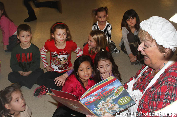 Mrs. Claus reads The Night Before Christmas to the Children at the Christmas party with Santa for the children at the St. Gerard Majella Church in Canton on Saturday, December 14, 2014.(Photo by Gary Wilcox)